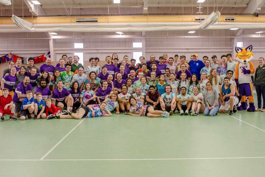 The students, in tye dye, and alumni, in purple, compete in the tournament