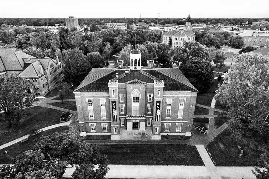 Old Main viewed from above, with the town of Galesburg in the background