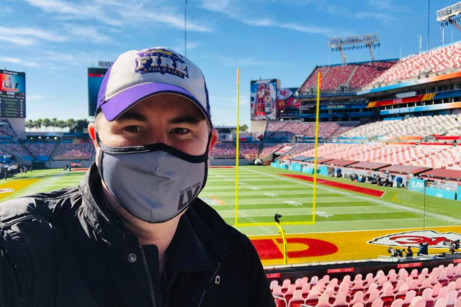 Andrew Isaacson '99 stands inside Raymond James Stadium at Super Bowl LV in Tampa