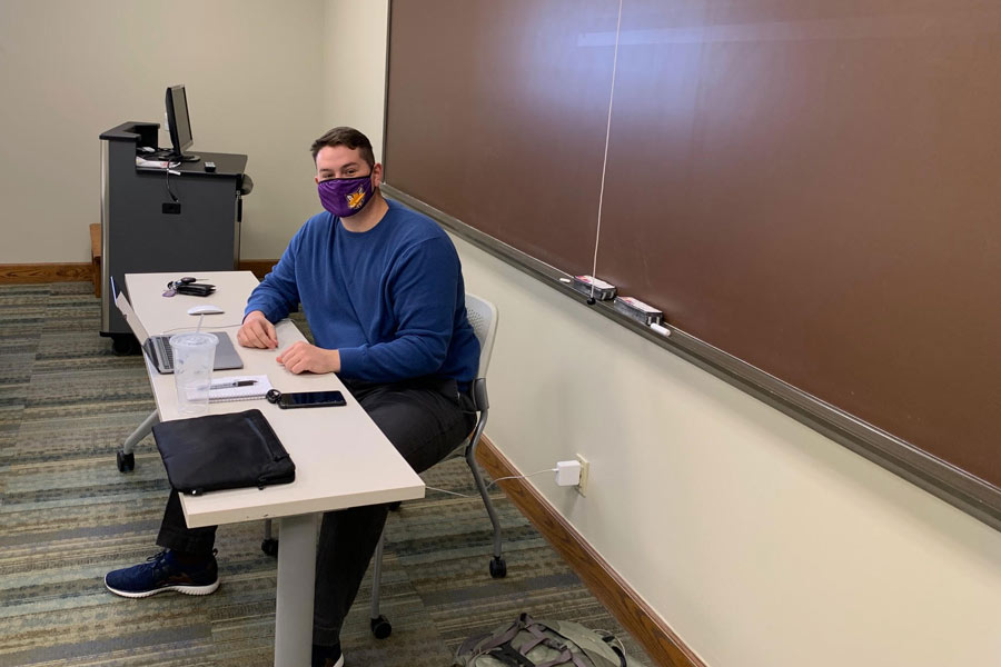 Student teacher Connor McClelland set up his remote high school classroom in an empty Knox classroom